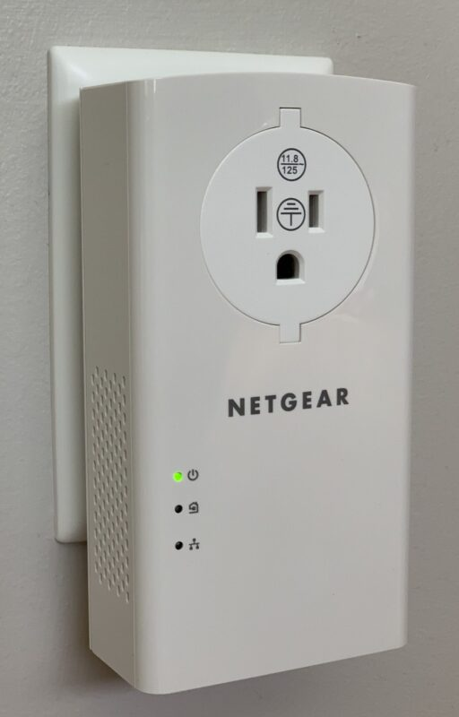 The Netgear PLP2000's front face has a power outlet and indicator LEDs.