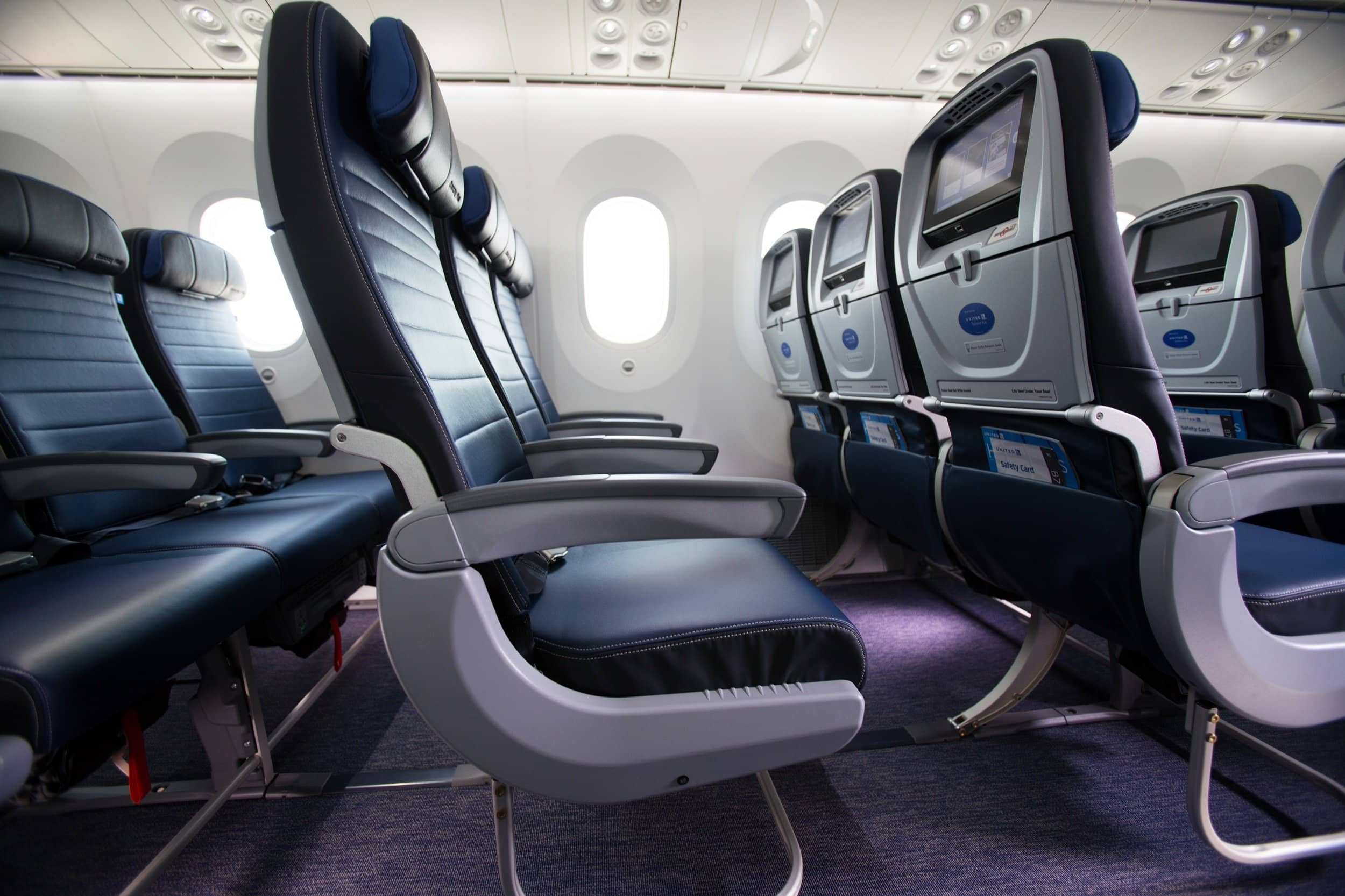 Row of economy seats on a United Airlines plane